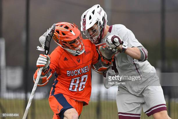 Connor O'Hara of the Bucknell Bison gets hit by Danny Healey of the Colgate Raiders on a dodge to the goal during the second half at Andy Kerr...