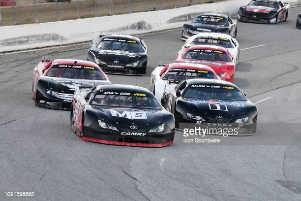 Connor Okrzesik Toyota Camry leads Kyle Rowdy Busch KBR Toyota Camry and Casey Roderick Ronnie Sanders Racing Ford Fusion in the closing laps of the...