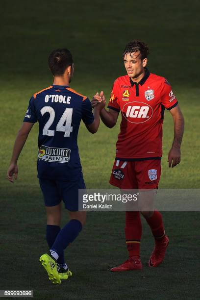 Connor O'Toole of the Roar ad Nikola Mileusnic of United shake hands after the the round 13 ALeague match between Adelaide United and Brisbane Roar...
