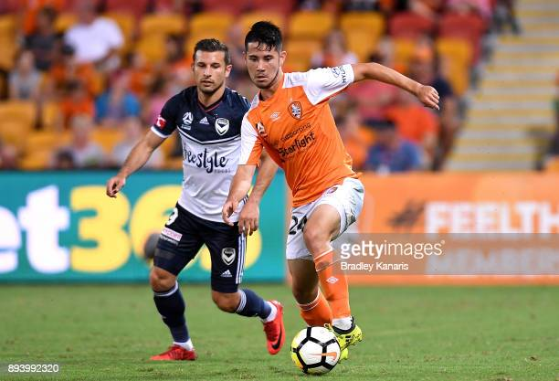 Connor O'Toole of the Roar breaks away from the defence during the round 11 ALeague match between the Brisbane Roar and the Melbourne Victory at...