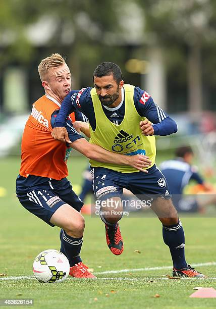 Connor Pain and Fahid Ben Khalfallah of the Victory contest for the ball during a Melbourne Victory ALeague training session at Gosch's Paddock on...