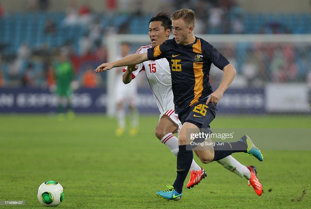 Connor Pain of Australia competes for the ball with Wu Xi of China during the EAFF East Asian Cup match between Australia and China at Jamsil Stadium on July 28, 2013 in Seoul, South Korea.