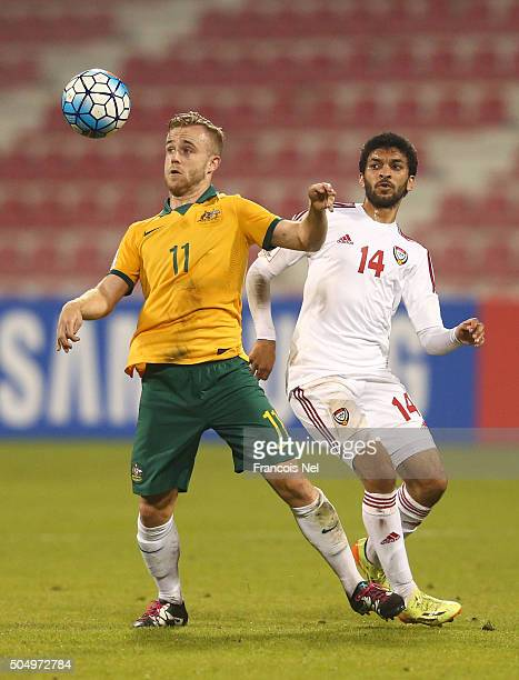 Connor Pain of Australia controls the ball under pressure from Abdulla Mohd of the United Arab Emirates during the AFC U23 Championship Group D match...