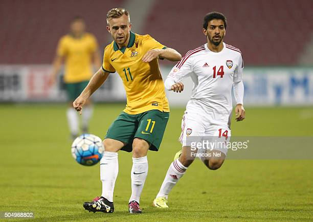 Connor Pain of Australia is closed down by Abdulla Mohd of the United Arab Emirates during the AFC U23 Championship Group D match between Australia...