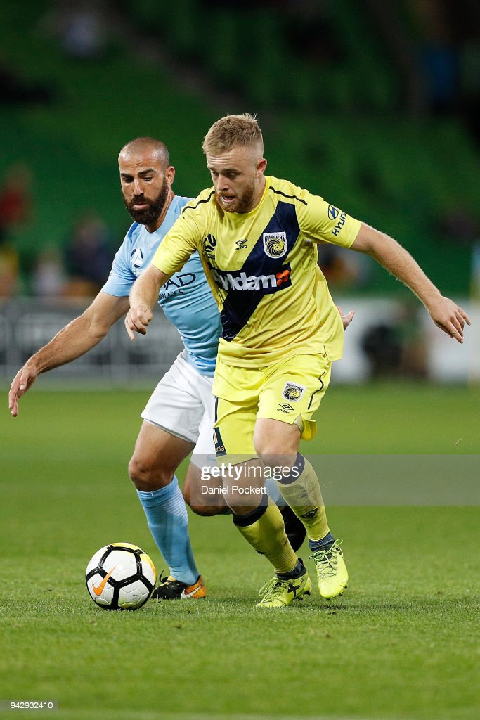 Connor Pain of Central Coast Mariners and Emmanuel Muscat of Melbourne City during the round 26 A-League match between Melbourne City and the Central Coast Mariners at AAMI Park on April 7, 2018 in Melbourne, Australia.