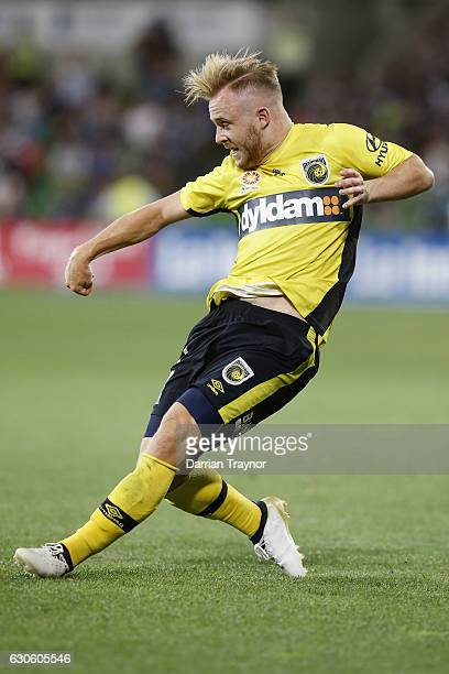 Connor Pain of Central Coast Mariners kicks the ball during the round 12 ALeague match between Melbourne Victory and Central Coast Mariners at AAMI...