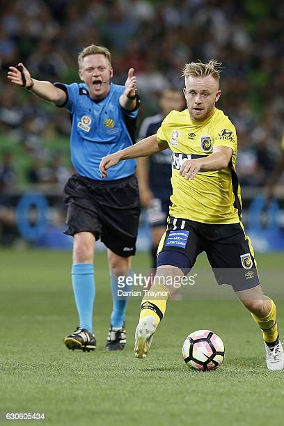 Connor Pain of Central Coast Mariners runs with the ball during the round 12 ALeague match between Melbourne Victory and Central Coast Mariners at...