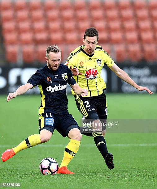 Connor Pain of Gold Coast and Jacob Tratt of Wellington contest the ball during the round 10 ALeague match between the Wellington Phoenix and the...
