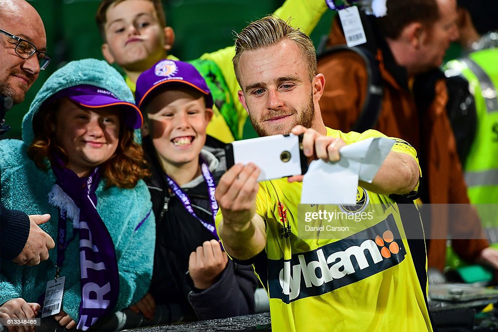 Connor Pain of the Central Coast Mariners celebrates the draw a selfie with the fans during the round one A-League match between the Perth Glory and the Central Coast Mariners at nib Stadium on October 8, 2016 in Perth, Australia.