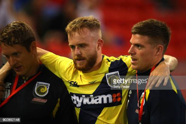 Connor Pain of the Mainers is carried from the ground during the round 15 ALeague match between the Newcastle Jets and the Central Coast Mariners at...