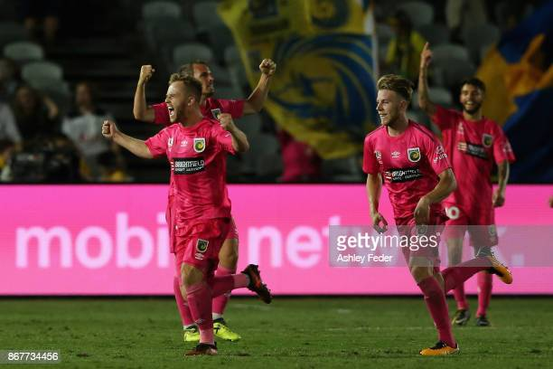 Connor Pain of the Mariners celebrates a goal with his team mates during the round four ALeague match between the Central Coast Mariners and the...