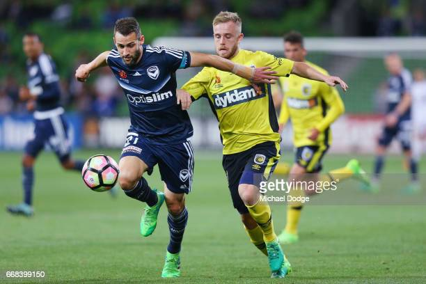 Connor Pain of the Mariners competes the ball against Carl Valeri of the Victory during the round 27 ALeague match between the Melbourne Victory and...
