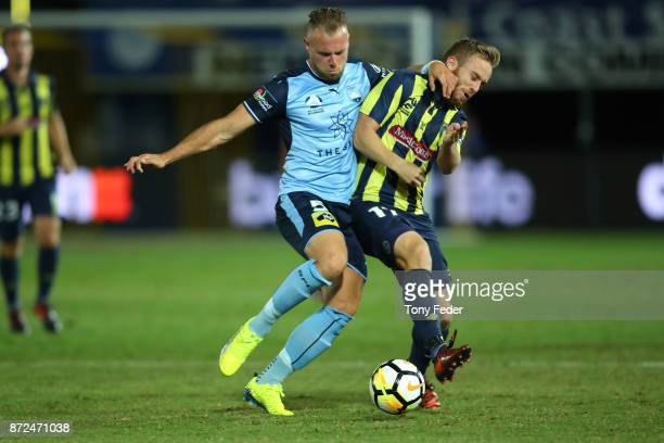 Connor Pain of the Mariners contests the ball with Jordy Buijs of Sydney FC during the round six ALeague match between the Central Coast Mariners and...