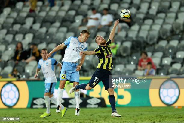 Connor Pain of the Mariners contests the header against Alexander Wilkinson of Sydney FC during the round 24 ALeague match between the Central Coast...