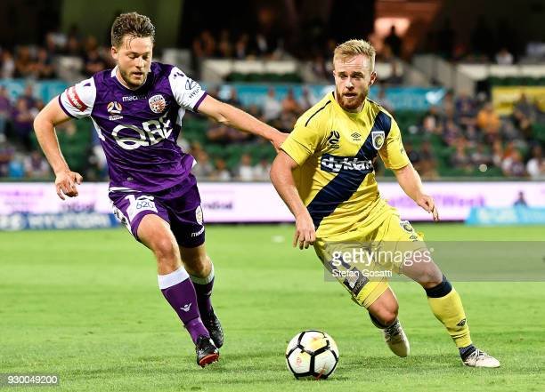 Connor Pain of the Mariners controls the ball against Chris Harold of the Glory during the round 22 ALeague match between the Perth Glory and the...