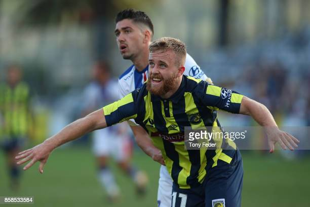 Connor Pain of the Mariners defends his position during the round one ALeague match between the Central Coast Mariners and the Newcastle Jets at...