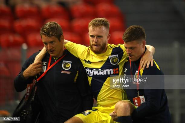Connor Pain of the Mariners is carried from the field during the round 15 ALeague match between the Newcastle Jets and the Central Coast Mariners at...