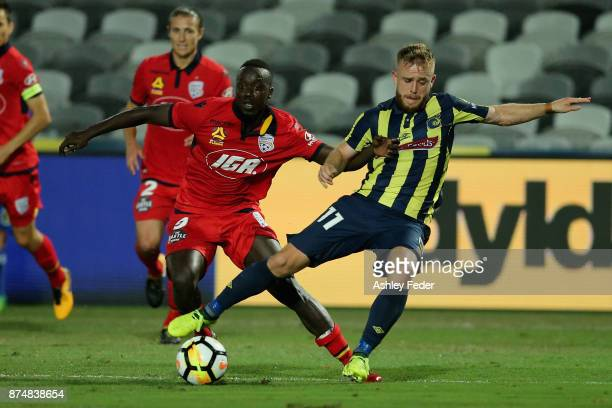 Connor Pain of the Mariners is fouled by Papa Babacar Diawara of Adelaide resulting in a penalty kick during the round seven ALeague match between...