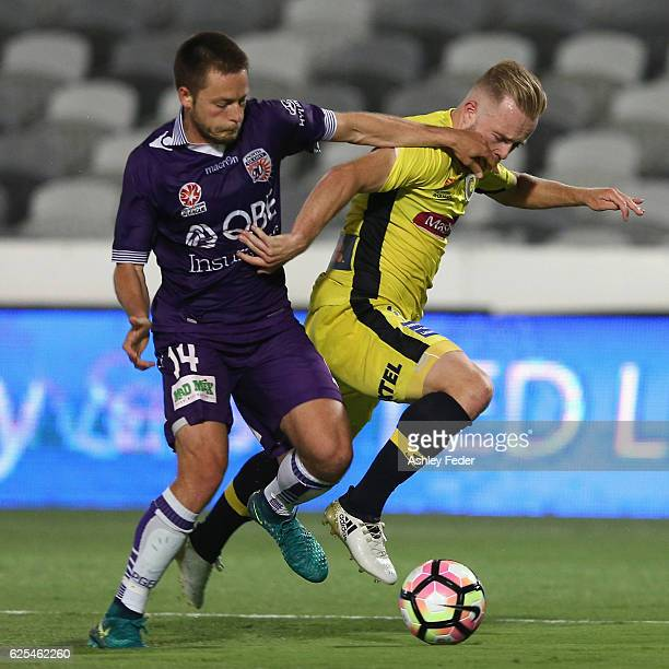 Connor Pain of the Mariners is tackled by Chris Harold of the Glory during the round eight ALeague match between the Central Coast Mariners and the...