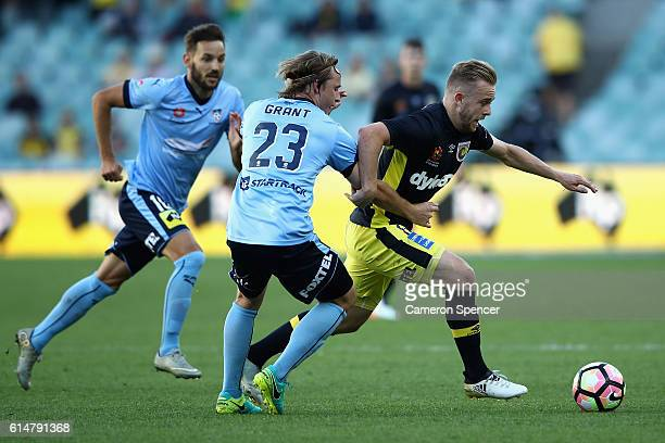 Connor Pain of the Mariners is tackled during the round two ALeague match between Sydney FC and the Central Coast Mariners at Allianz Stadium on...
