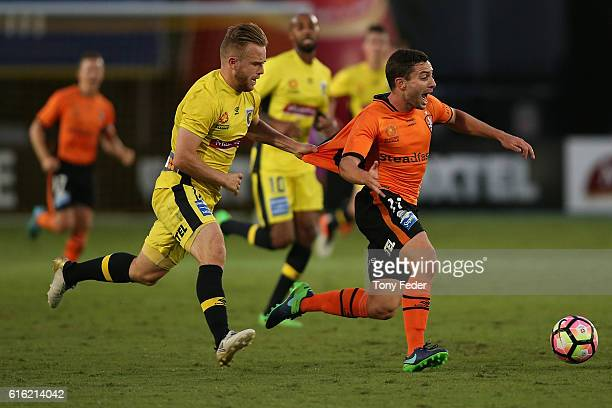 Connor Pain of the Mariners pulls the shirt of Thomas Oar of the Roar during the round three A-League match between the Central Coast Mariners and...