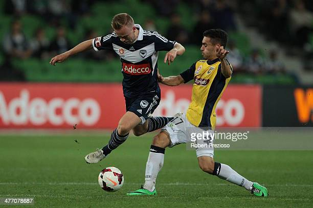 Connor Pain of the Victory and Anthony Caceres of the Mariners contest the ball during the round 21 ALeague match between Melbourne Victory and the...