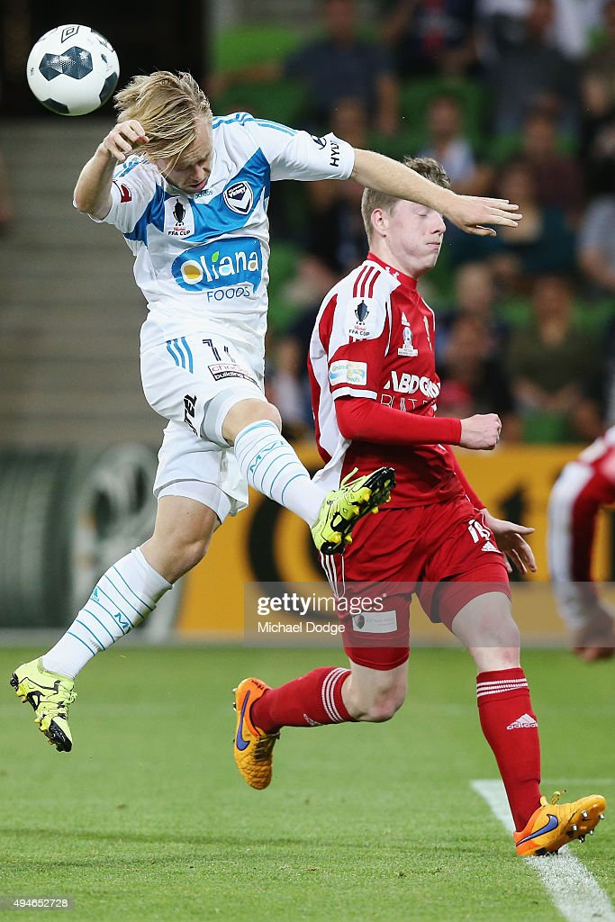Connor Pain of the Victory headers the ball for a goal attempt past Matthew Hennessey of the City during the FFA Cup Semi Final match between Hume City and Melbourne Victory at AAMI Park on October 28, 2015 in Melbourne, Australia.