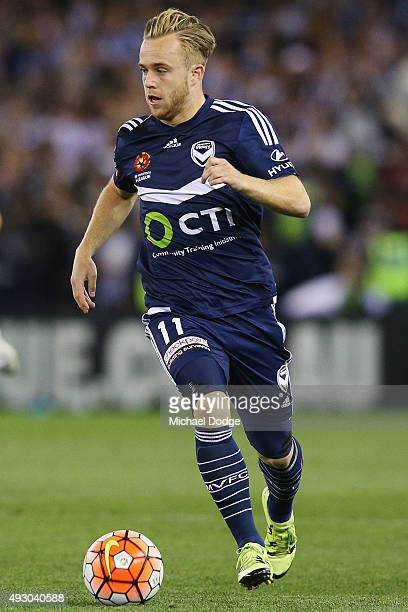 Connor Pain of the Victory runs with the ball during the round two ALeague match between Melbourne Victory and Melbourne City FC at Etihad Stadium on...