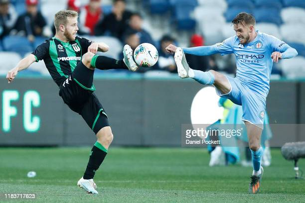 Connor Pain of Western United and Craig Noone of Melbourne City contest the ball during the round three ALeague match between Western United and...