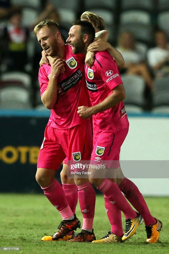 Connor Pain on the Mariners celebrates his goal with team mate Joshua Rose of the Mariners during the round four A-League match between the Central Coast Mariners and the Melbourne Victory at Central Coast Stadium on October 29, 2017 in Gosford, Australia.