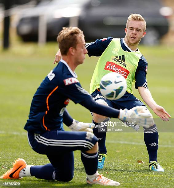 Connor Pain tries to get the ball past keeper Lawrence Thomas during a Melbourne Victory ALeague training session at Gosch's Paddock on February 4...