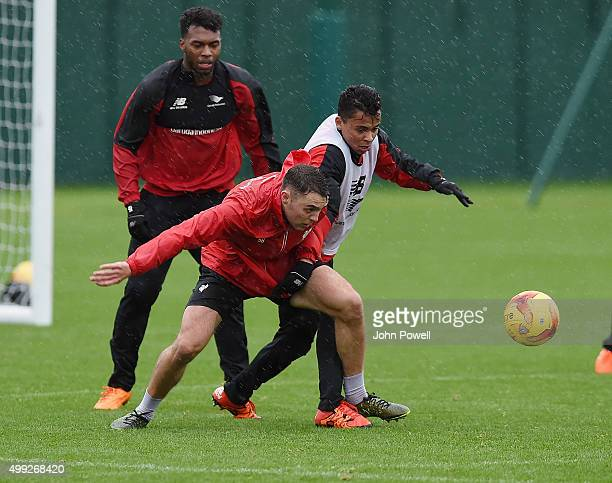 Connor Randall and Allan Rodrigues de Souza of Liverpool during a training session at Melwood Training Ground on November 30 2015 in Liverpool England