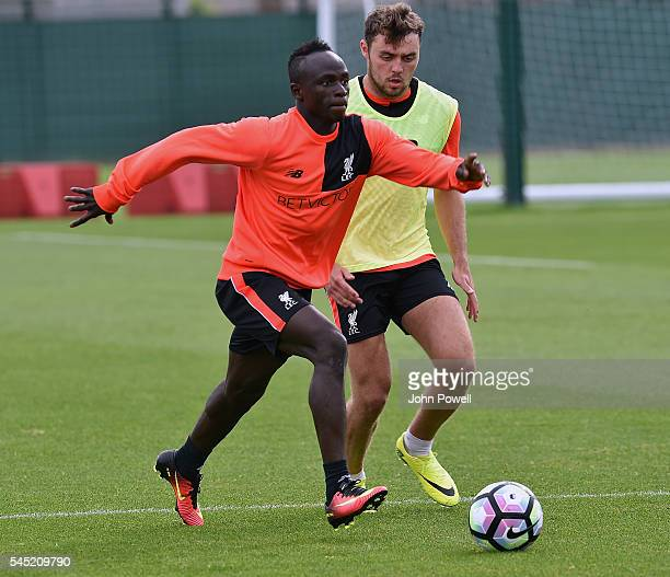 Connor Randall and Sadio Mane of Liverpool during a training session at Melwood Training Ground on July 6 2016 in Liverpool England