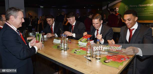 Connor Randall Ben Woodburn Harry Wilson and Trent AelxanderArnold of Liverpool sign autographs during the Liverpool FC Player Awards at Anfield on...