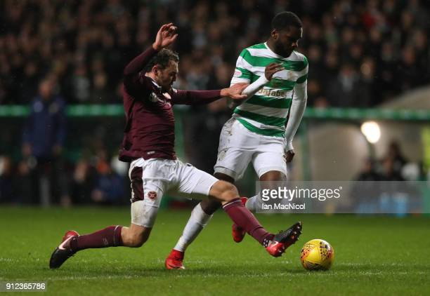 Connor Randall of Heart of Midlothian vies with Odsonne Edouard of Celtic during the Scottish Premier League match between Celtic and Heart of...