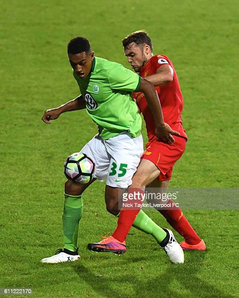 Connor Randall of Liverpool and Anton Donkor of Wolfsburg in action during the Liverpool v VFL Wolfsburg game at Prenton Park on September 28 2016 in...