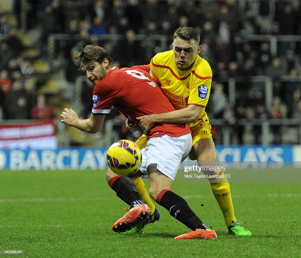 Connor Randall of Liverpool and Nick Powell of Manchester United in action during the Barclays U21 Premier League match between Manchester United and Liverpool at Leigh Sports Village on January 26, 2015 in Leigh, Greater Manchester.
