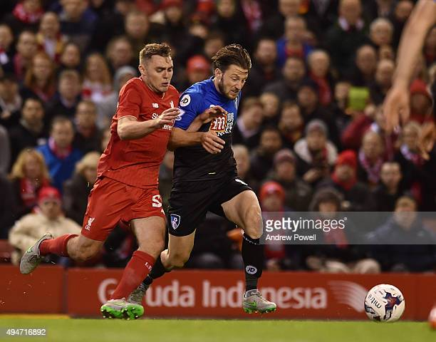 Connor Randall of Liverpool competes with Harry Arter of AFC Bournemouth during the Capital One Cup Fourth Round match between Liverpool and AFC...