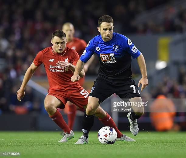 Connor Randall of Liverpool competes with Marc Pugh of AFC Bournemouth during the Capital One Cup Fourth Round match between Liverpool and AFC...