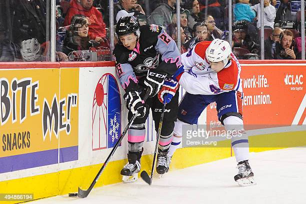 Connor Rankin of the Calgary Hitmen battles for the puck against Nik Andersen of the Spokane Chiefs during a WHL game at Scotiabank Saddledome on...
