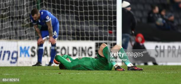 Connor Ripley of Oldham Athletic dejectedly lays on the floor after being beaten by a shot by Nicky Maynard of Milton Keynes Dons for his sides goal...