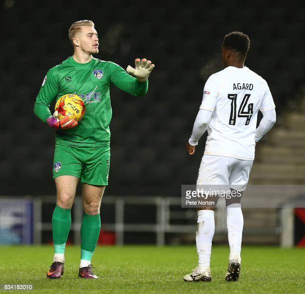 Connor Ripley of Oldham Athletic is watched by Kieran Agard of Milton Keynes Dons during the Sky Bet League One match between Milton Keynes Dons and...