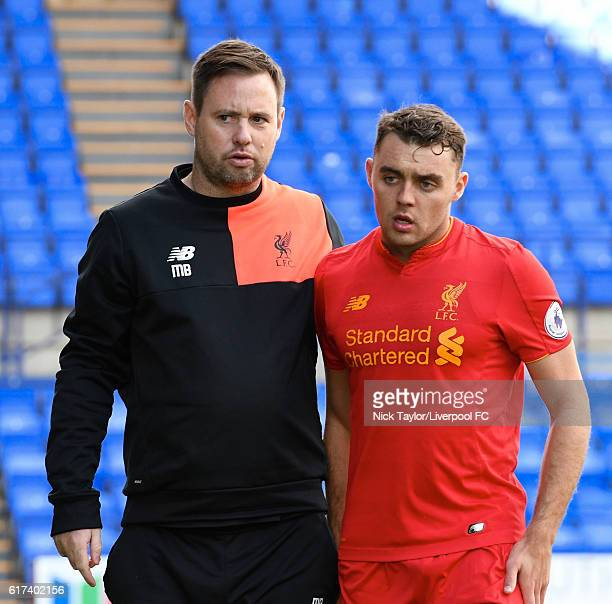 Connor Rnadall of Liverpool with the U23 coach Michael Beale during the Liverpool v Everton Premier League 2 game at Prenton Park on October 23 2016...
