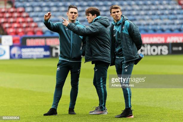 Connor Roberts Daniel James and Tom Carroll walk on the picth prior to the game during the Premier League match between Huddersfield Town and Swansea...