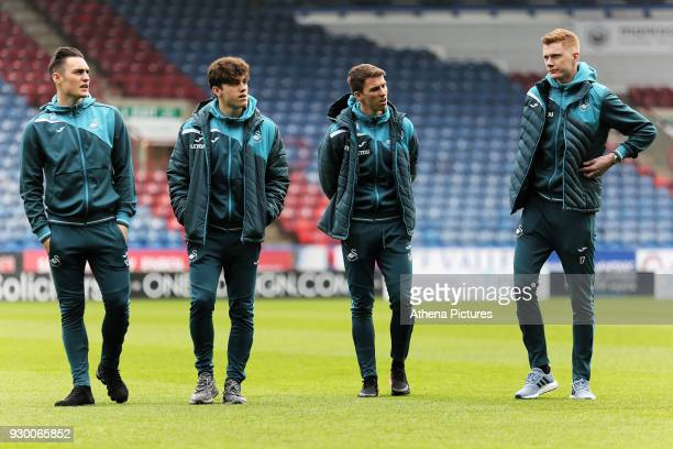 Connor Roberts Daniel James Tom Carroll and Sam Clucas of Swansea City walk on the picth prior to the game during the Premier League match between...
