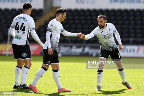 Connor Roberts fist bumps with Conor Hourihane of Swansea City during the Sky Bet Championship match between Swansea City and Preston North End at...