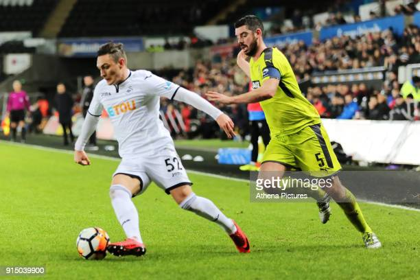 Connor Roberts of Swansea City chased by Richard Duffy of Notts County during The Emirates FA Cup match between Swansea City and Notts County at The...