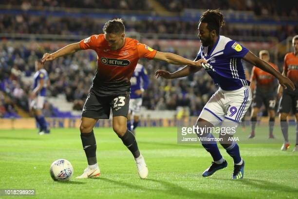 Connor Roberts of Swansea City holds off Jacques Maghoma of Birmingham City during the Sky Bet Championship match between Birmingham City and Swansea...