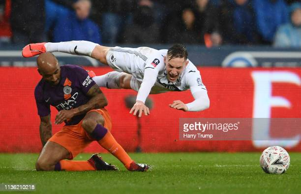 Connor Roberts of Swansea City is challenged by Fabian Delph of Manchester City which leads to a penalty during the FA Cup Quarter Final match...