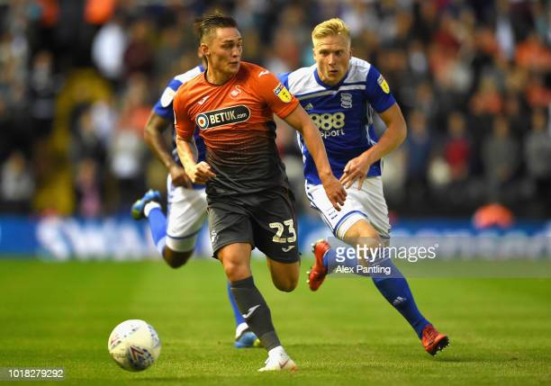 Connor Roberts of Swansea City is chased down by Kristian Pedersen of Birmingham City during the Sky Bet Championship match between Birmingham City...
